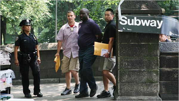 Darius McCollum being taken out of the 59th St-Columbus Circle station in June.