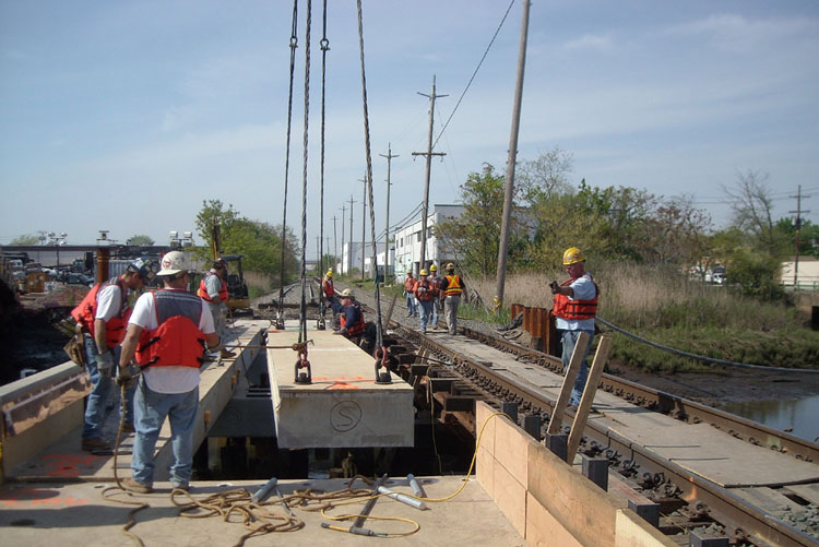 Setting the pre-cast concrete bridge deck panels at the Powell Creek.