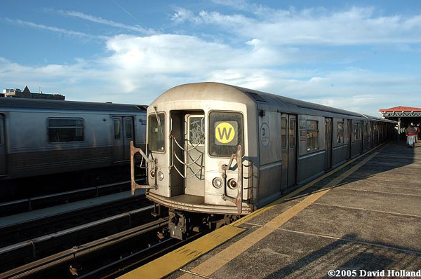 Astoria-Ditmars Boulevard bound W train departing the 36th Ave station.