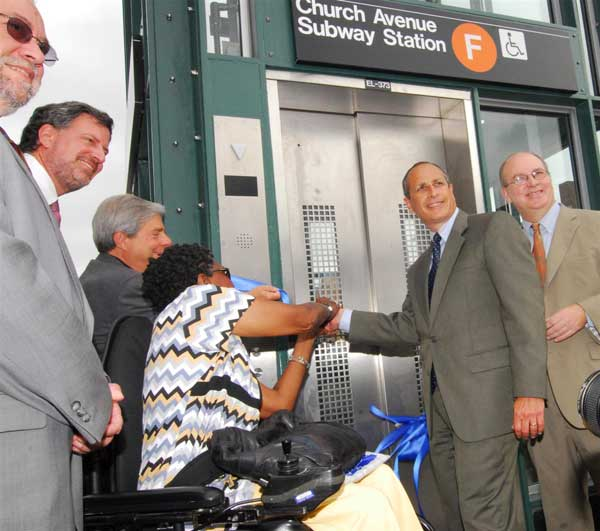 MTA officials at the Church Avenue F Station